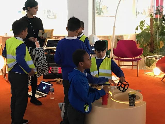 Three school children using augmented reality